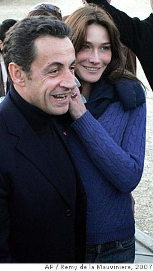 ** FILE ** France's President Nicolas Sarkozy and his girlfriend, former Italian model Carla Bruni are seen on a trip to Cairo, Egypt in this Dec. 30, 2007 file photo. Sarkozy married his girlfriend in a small ceremony Saturday, Feb. 2, 2008 at the presidential Elysee Palace, the mayor who performed the ceremony said. Sarkozy, 53, and Bruni, 40, have had a whirlwind courtship: They married less than three months after they reportedly first met, and less than four months after Sarkozy divorced his second wife, Cecilia. (AP Photo/Remy de la Mauviniere, file) Photo: REMY DE LA MAUVINIERE