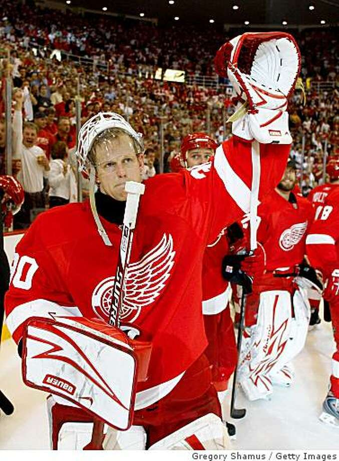 DETROIT - MAY 27:  Goalie Chris Osgood #30 of the Detroit Red Wings acjknowledges the fans after their 2-1 win in overtime against the Chicago Blackhawks during Game Five of the Western Conference Championship Round of the 2009 Stanley Cup Playoffs on May 27, 2009 at Joe Louis Arena in Detroit, Michigan.  (Photo by Gregory Shamus/Getty Images) Photo: Gregory Shamus, Getty Images