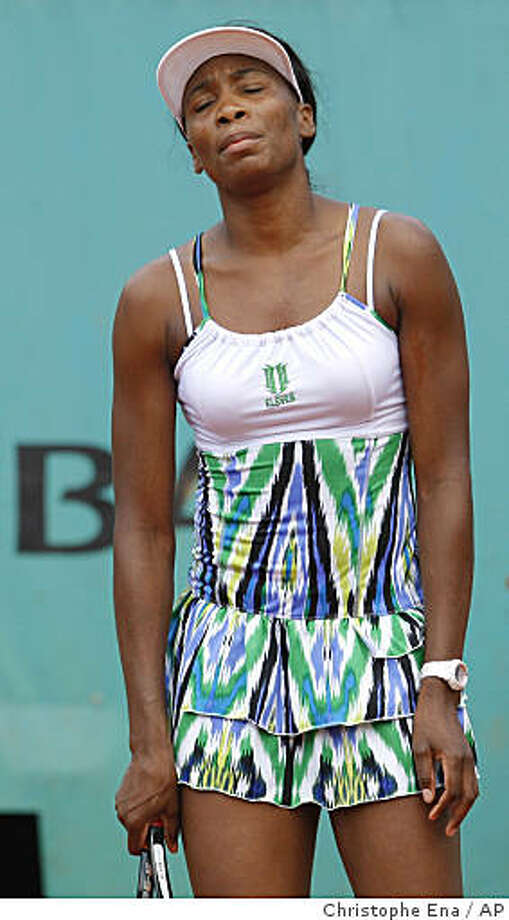 U.S. player Venus Williams reacts after losing her third round match against Hungary's Agnes Szavay at the Roland Garros stadium in Paris, Friday May 29, 2009. (AP Photo/Christophe Ena) Photo: Christophe Ena, AP