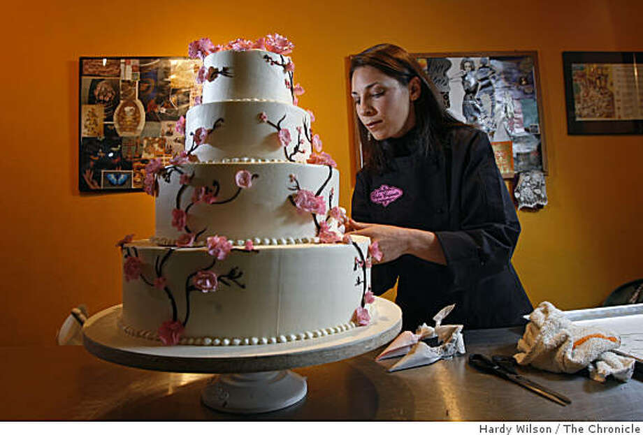 Gabrielle Feursinger, a wedding cake designer, puts the finishing touches on a cake in the rear of Maggie Mudd ice cream parlor where she works in San Francisco, Calif., on Friday, April 17, 2009. Photo: Hardy Wilson, The Chronicle