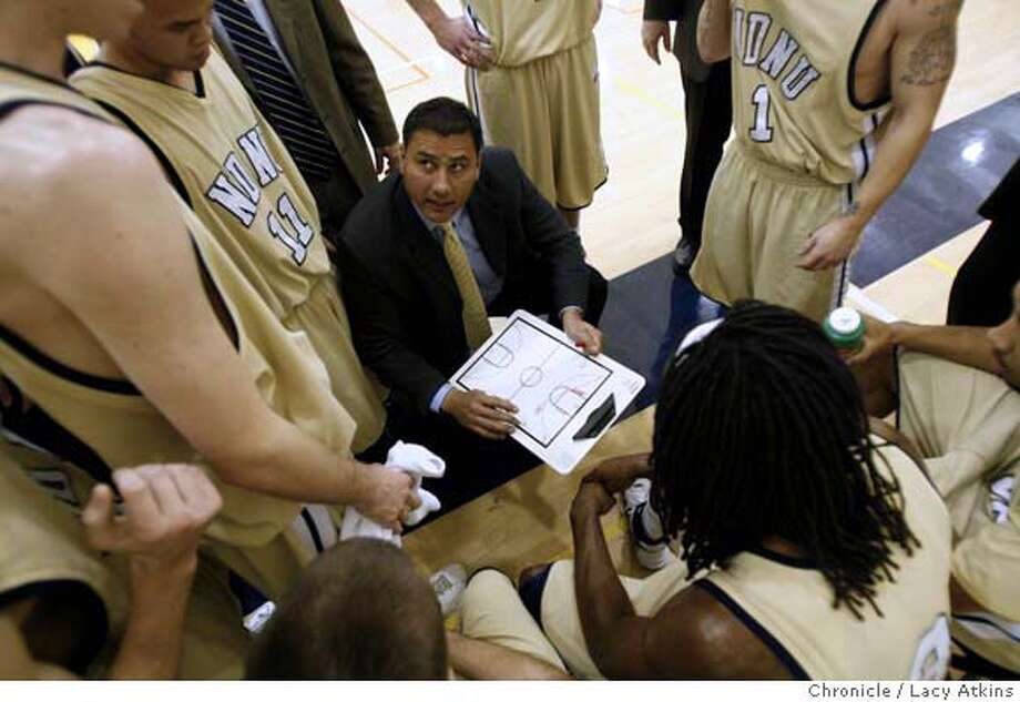 Notre Dame coach George Puou talks with team during a timeout against BYU Hawaii, January 2, 2008, in Belmont, Ca. (Lacy Atkins San Francisco Chronicle) MANDATORY CREDIT FOR PHOTOG AND SAN FRANCISCO CHRONICLE/NO SALES-MAGS OUT Photo: Lacy Atkins