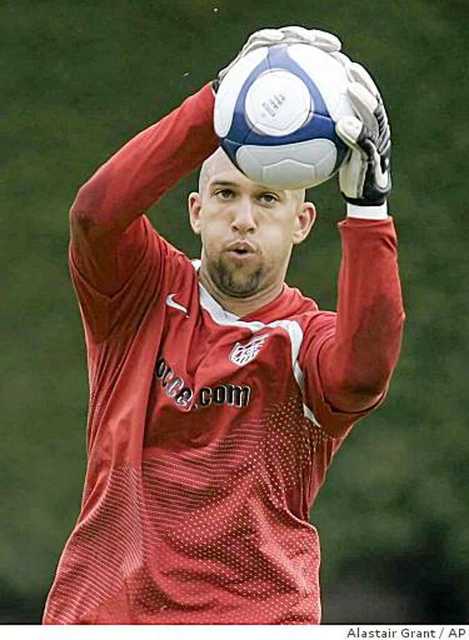 ** FOR USE AS DESIRED WITH CONFEDERATIONS CUP SOCCER STORIES ** FILE - In this May 27, 2008, file photo, United States soccer goalkeeper Tim Howard grabs the ball during a training session in London. (AP Photo/Alastair Grant, File) Photo: Alastair Grant, AP