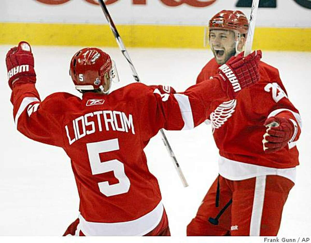 Detroit Red Wings defenceman Brian Rafalski celebrates with defenceman Nicklas Lidstrom, of Sweden, after scoring the fourth goal against the Pittsburgh Penguins during second period of Game 5 of the NHL hockey Stanley Cup finals in Detroit, Saturday, June 6, 2009. (AP Photo/The Canadian Press,Frank Gunn)