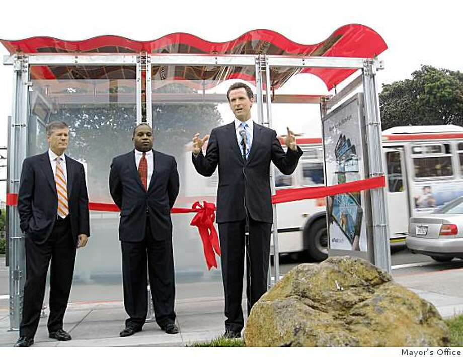 Mayor Gavin Newsom, left, speaks at unveiling of new city bus shelters, which feature solar panels. ABout 1,100 shelters will be revamped in coming years. Photo: Mayor's Office