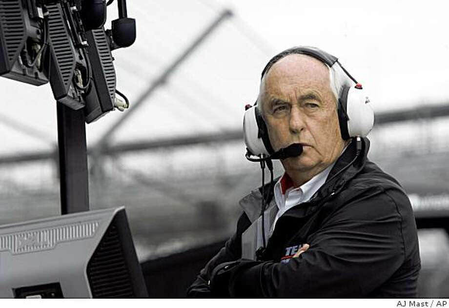 In this file photo taken on  Friday, May 8, 2009, team owner Roger Penske looks on during practice for the Indianapolis 500 auto race at the Indianapolis Motor Speedway in Indianapolis. A person briefed on the deal said Friday, June 5, 2009, General Motors Corp. will sell its Saturn brand to former race car driver and dealership chain owner Roger Penske. (AP Photo/AJ Mast) Photo: AJ Mast, AP