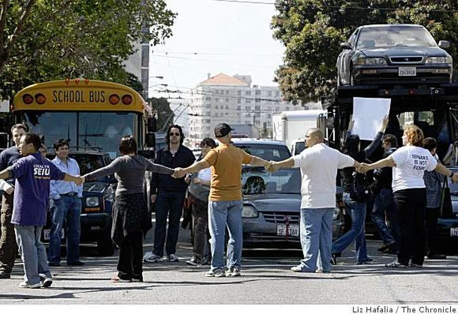 Protestors form a barrier on Van Ness Avenue and Grove Street in San Francisco. Photo: Liz Hafalia, The Chronicle