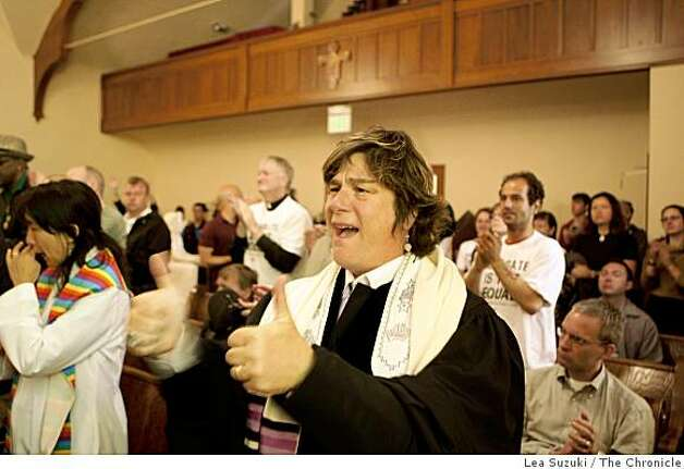 Rabbi Camille Shira Angel of Congregation Sha-ar Zahav cheers with others during service at St. Francis Lutheran Church in  San Francisco on Tuesday. Photo: Lea Suzuki, The Chronicle