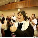 Rabbi Camille Shira Angel of Congregation Sha-ar Zahav cheers with others during service at St. Francis Lutheran Church in  San Francisco on Tuesday.