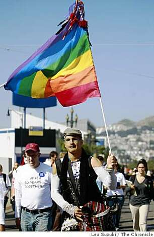 Pangaea Garza of San Francisco marches with others up Market Street in  San Francisco on Tuesday. Photo: Lea Suzuki, The Chronicle
