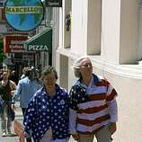 Yvonne Duncan (l to r) and Emilie Krustapentus, both of San Francisco, walk up Castro street in  San Francisco, Calif. on Tuesday, May 26, 2009. Both had attended the rally at City Hall earlier.