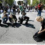 Brady Pearson from Oakland kneels down to pray in the center of Van Ness at Grove streets in San Francisco Tuesday, May 26, 2009.