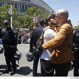 Robert Franco (left) and Shawn Higgins (right) kiss as they wait to get arrested on Van Ness at Grove avenues in San Francisco, Calif., on Monday, May 26, 2009.