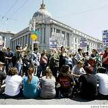 Demonstrators sit down at Van Ness at Grove streets. Protestors took part in a civil disobedience demonstration that blocked traffic on Van Ness following the California Supreme Courts decision upholding of Prop 8 vote, the ban on gay marriage.