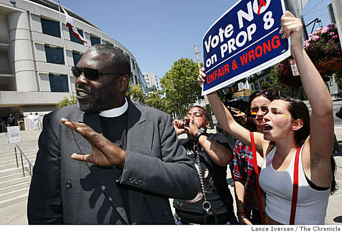 Asst Pastor Chauncey Killens from Salinas Ca gets a police escort after he tried to preach to anti Prop 8 demonstrators who were taking part in a civil disobedience demonstration blocking traffic for several hours following the California Supreme Courts decision upholding of Prop 8 vote, the ban on gay marriage. Tuesday, May 26, 2009.
