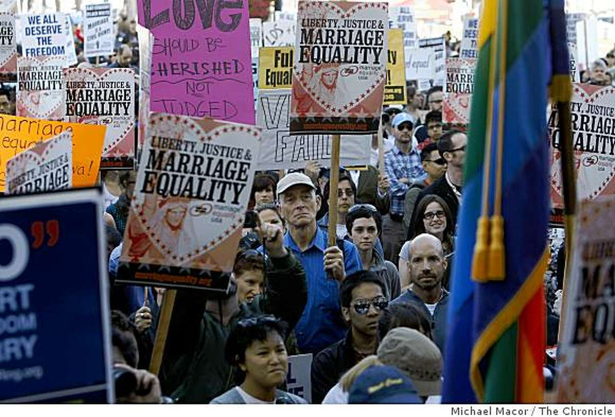 Supporters listen to speakers during an evening rally on the steps of City Hall in San Francisco, Calif. on Tuesday, May 26, 2009, after the California Supreme Court ruled this morning to uphold Proposition 8.