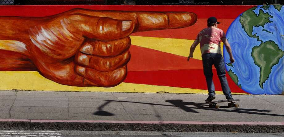 A skateboarder rolls past a mural at a CCSF campus at Hayes Street and Masonic Avenue in the Nopa neighborhood in San Francisco, Calif., on Thursday, May 21, 2009. Photo: Paul Chinn, The Chronicle