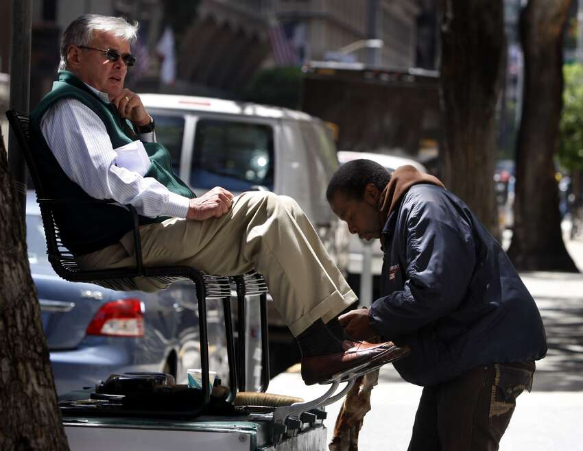 Donald Drummond has his shoes shined by Bryan Curlee at California and Davis streets in the Financial District of San Francisco, Calif., on Wednesday, May 20, 2009. A new Board of Realtors map to be released soon will rename the area as the Barbary Coast neighborhood.