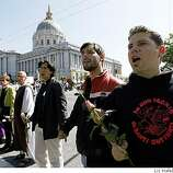 Protestors form a barrier on Van Ness at Grove avenues in the civic center in San Francisco, Calif., on Monday, May 26, 2009.