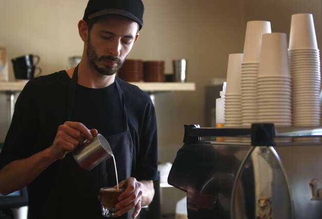Brian DeSimone makes one of his famed lattes at the Piccino cafe in the Dogpatch neighborhood in San Francisco, Calif., on Wednesday, May 20, 2009. Men's Journal magazine recently called Dogpatch one of the best neighborhoods in the country. Photo: Paul Chinn, The Chronicle