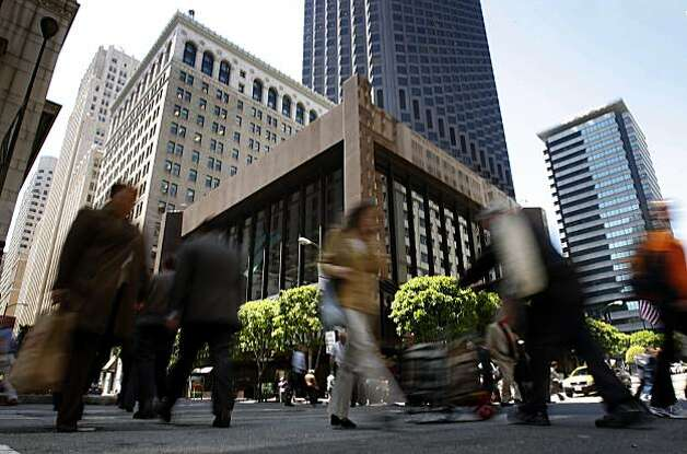 Office workers cross the busy the Financial District intersection of California and Montgomery streets in San Francisco, Calif., on Thursday, May 21, 2009. A new Board of Realtors map to be released soon will rename the area as the Barbary Coast neighborhood. Photo: Paul Chinn, The Chronicle
