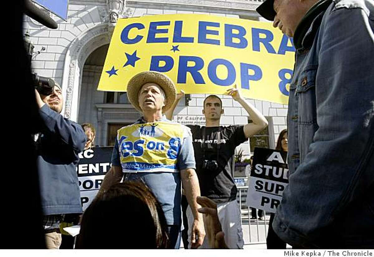An anti-gay marriage supporter who declined to give his name argues with same-sex marriage supporters outside the California Supreme Court.