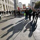 Marchers make their way down McAllister St. following a rally at City Hall, in San Francisco, Calif. on Tuesday May 26, 2009, after the California Supreme Court ruled this morning to uphold Proposition 8.