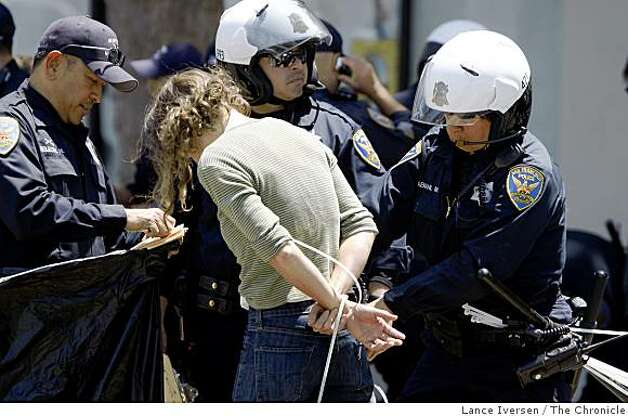San Francisco Police officers remove personal items from a female protestor on Grove Street in San Francisco Tuesday, May 26, 2009. Demonstrators took part in a civil disobedience demonstration that blocked traffic for several hours on Van Ness Ave following the California Supreme Courts decision upholding of Prop 8 vote, to ban on gay marriage. Photo: Lance Iversen, The Chronicle