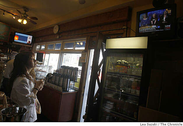 Motoko Hosokawa (left) of San Francisco catches the news at The Castro Cheesery shortly after the Supreme Court decision on Prop 8 is announced in San Francisco, Calif. on Tuesday, May 26, 2009. Photo: Lea Suzuki, The Chronicle