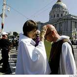 Reverend Kaaren Ray (left), from Inclusive Celtic Church in San Francisco, giving blessings to protestors as they form a barrier on Van Ness at Grove avenues in the civic center in San Francisco, Calif., on Monday, May 26, 2009.