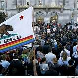 Hundreds gathered in front of city Hall for a rally in support of gay rights, in San Francisco, Calif. on Tuesday May 26, 2009, after the California Supreme Court ruled this morning to uphold Proposition 8.