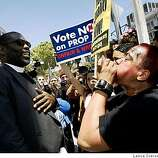 Assistant Pastor Chauncey Killens (left) from Salinas is confronted by Aleada Minton from San Francisco following the California Supreme Courts decision upholding of Prop 8 vote, the ban on gay marriage.
