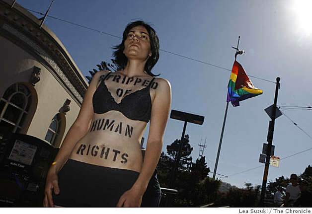 Performance artist Helaine Gawlica of San Diego stands at the corner of Castro and Market Streets for a day of decision performance in San Francisco, Calif. on Tuesday, May 26, 2009.  Gawlica is doing site specific performances throughout downtown San Francisco at L.G.B.T. and human rights locations. Photo: Lea Suzuki, The Chronicle