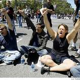 Protestors chant as police approach Van Ness at Grove avenues in the civic center in San Francisco, Calif., on Monday, May 26, 2009.