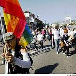 Pangaea Garza of San Francisco marches with others up Market Street in  San Francisco.