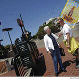 "Pat Tibbs (left) and Richard Ceely, both of San Francisco, talk at Market and Castro streets on Tuesday.  Ceely had attended the rally earlier and Tibbs had been at home on her computer when she decided she had to go down to the Castro to be with people who ""get it"". She said that she didn't want to get married but wanted the right to choose to."