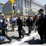 Police prepare to arrest protestors on Van Ness at Grove avenues in the civic center in San Francisco, Calif., on Monday, May 26, 2009.