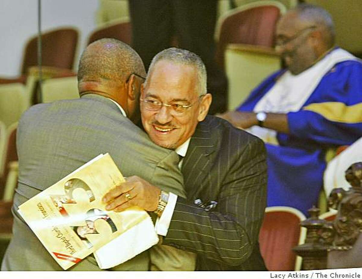 Rev. Amos Brown greets Rev. Jeremiah Wright with a hug when he introduce him to the crowd to deliver the sermon to celebrate Amos Brown's 33 year of preaching at the Third Baptist Church, Sunday June 7, 2009, in San Francisco, Calif.