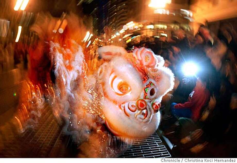 """A lion makes its way down Market St.. The San Francisco Chinese New Year Parade celebrates """" Year of the Pig."""" Firecrackers, elaborate costumes, the newly crowned Miss Chinatown and the 201' Golden Dragon will wind their way through the streets of downtown San Francisco. (Christina Koci Hernandez/The Chronicle) Ran on: 02-03-2008  Rachel Fong, from the Foster City Chinese Club, took part in the parade last year. Photo: Christina Koci Hernandez/CHRONIC"""