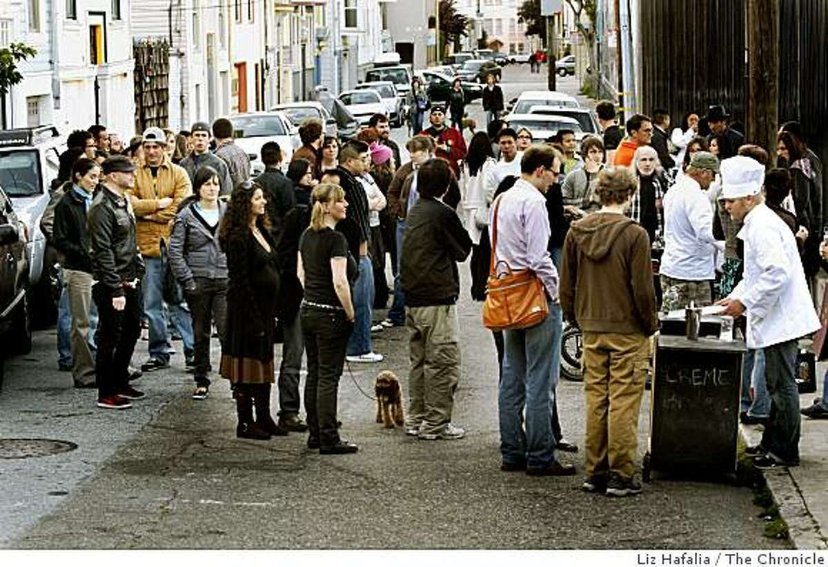 Food seekers line up for the Creme Brulee man in the mission district in San Francisco, Calif., on Friday, May 15, 2009.