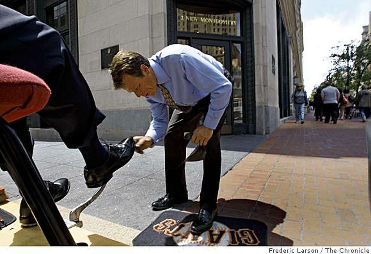 Larry Moore is the homeless shoeshine guy who works at the corner of Montgomery and Market Street wearing a tie and blazer, but still sleeps under a bridge on June 2, 2009.