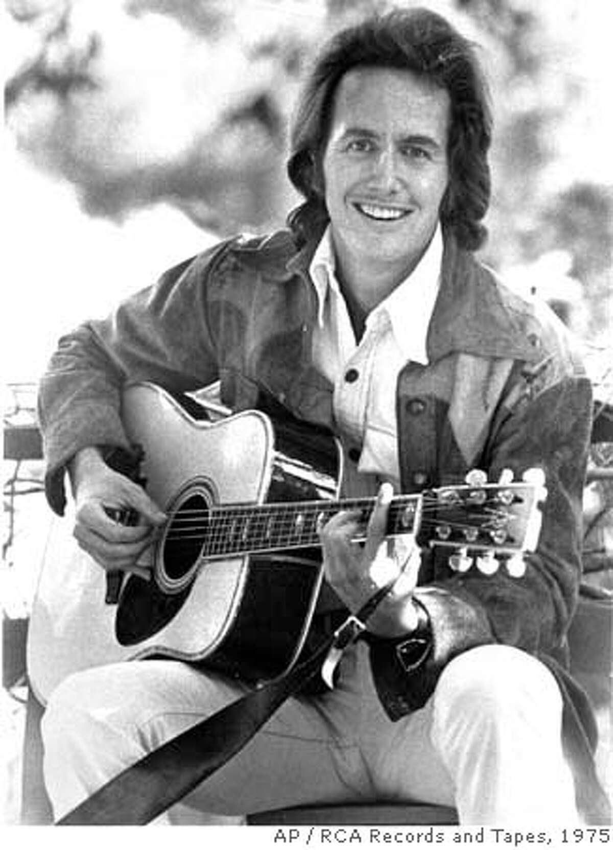 ** FILE ** This 1975 file picture shows musician John Stewart. Stewart, who came to prominence in the 1960s as a member of folk music's Kingston Trio, died Saturday, Jan. 19, 2008, at a San Diego hospital after suffering a brain aneurism. He was 68. (AP Photo/RCA Records and Tapes, File) **NO SALES** NO SALES