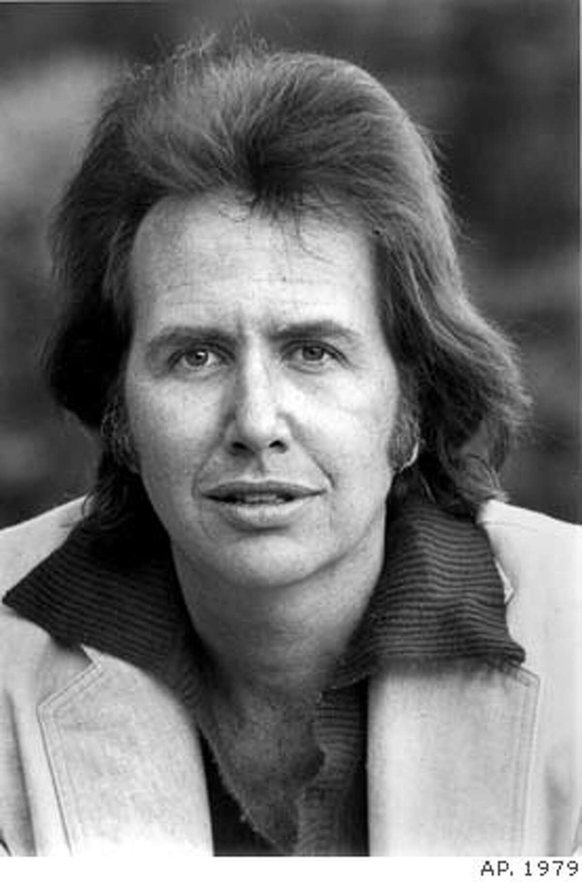 ** FILE ** This 1979 file picture shows musician John Stewart. Stewart, who came to prominence in the 1960s as a member of folk music's Kingston Trio, died Saturday, Jan. 19, 2008 at a San Diego hospital after suffering a brain aneurism. He was 68. (AP Photo)