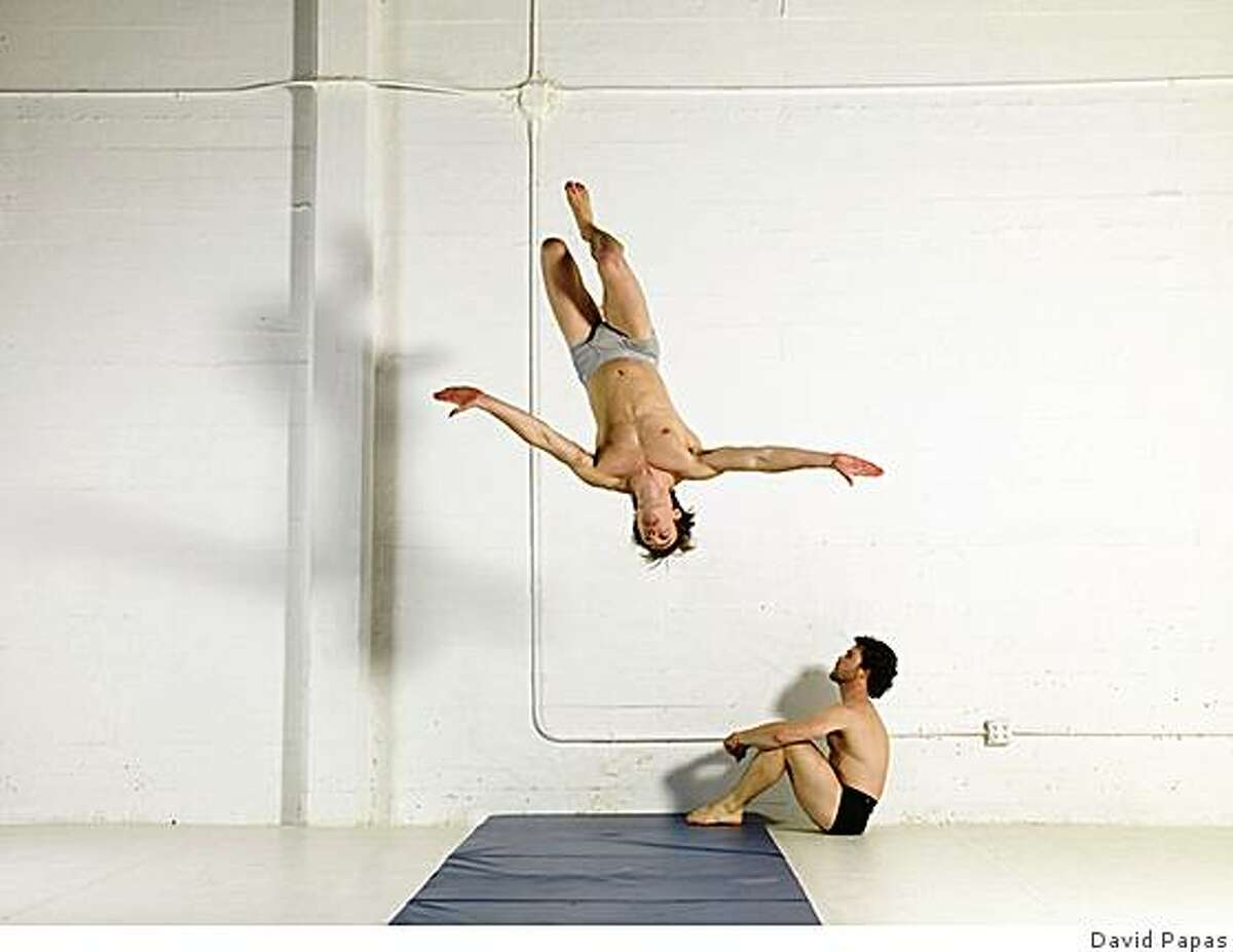 the dancer flipping off the wall is Ryder Darcy, seated is Sebastian Grubb.