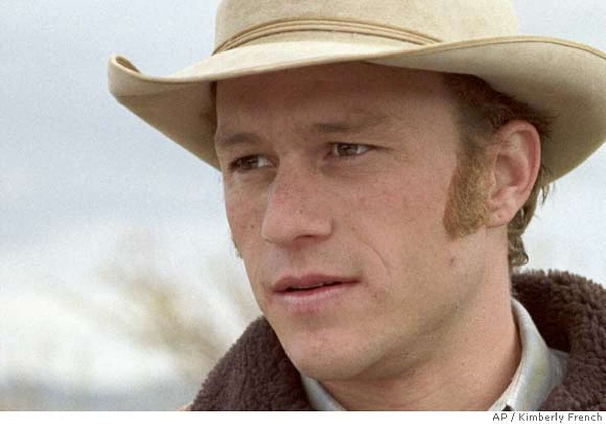 """In this photo provided by Focus Features, Ennis Del Mar( Heath Ledger,left) and Jack Twist (Jake Gyllenhaal) are two cowboys from very different backgrounds who meet and fall in love while working together in """"Brokeback Mountain."""" (AP Photo/ Focus Features/ Kimberly French) NO SALES. NO MAGAZINES"""