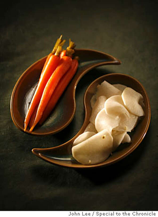 SEASONAL_30_JOHNLEE.JPG  Pickle recipes for Seasonal Cook.  By JOHN LEE/SPECIAL TO THE CHRONICLE  Ran on: 01-30-2008  Pickled Carrots from Bar Bambino and Quick Pickled Daikon with Lemon, at right. See recipes, F4. Photo: John Lee