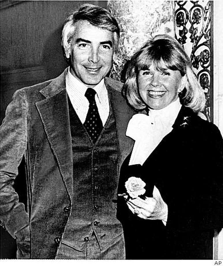 FILE - This undated file image shows Barry Comden, left, a maitre d' at a Beverly Hills restaurant who became the fourth husband of singer-actress Doris Day, right. Comden died of heart failure on May 25, 2009 in Los Angeles, according to his son. (AP Photo/file) Photo: AP