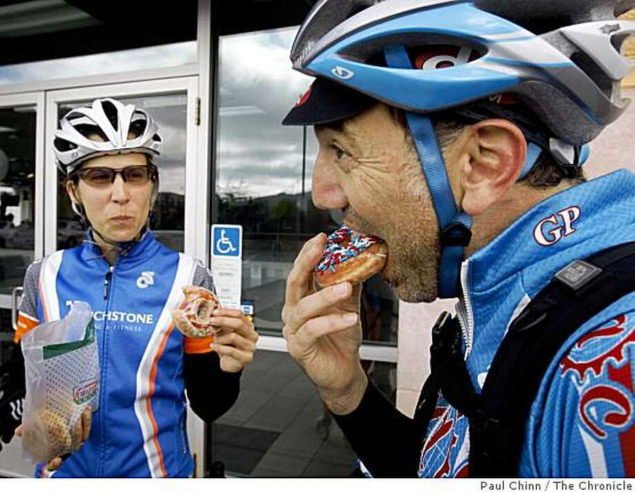 Amy Padula and Scott Rossi pedaled all the way from San Francisco to collect their free doughnut from Krispy Kreme, in celebration of National Doughnut Day, in Daly City, Calif., on Friday, June 5, 2009. Photo: Paul Chinn, The Chronicle