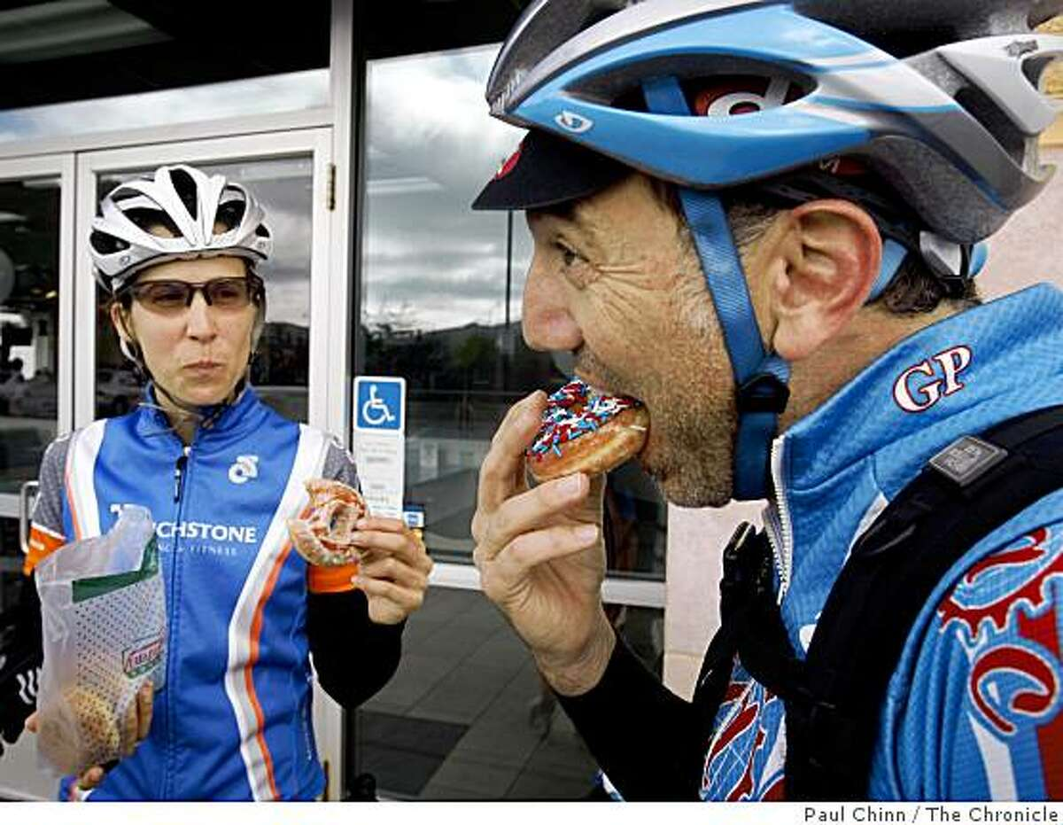 Amy Padula and Scott Rossi pedaled all the way from San Francisco to collect their free doughnut from Krispy Kreme, in celebration of National Doughnut Day, in Daly City, Calif., on Friday, June 5, 2009.