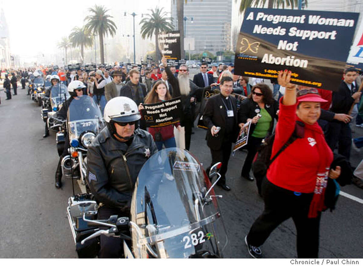 Police officers on foot and motorcycle escorted a large group of anti- demonstrators on the Embarcadero during the fourth annual Walk for Life march in San Francisco, Calif. on Saturday, Jan. 19, 2008. The anti- event drew several thousand supporters and attracted a smaller group of pro-choice counter demonstrators. The two groups held rallies near the Ferry Building then marched along the waterfront to the Marina Green.