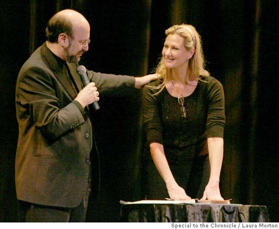 """Janice Ervin participates in a psychic entertainment performance with parapsychologist Loyd Auerbach, performing under the guise of """"Professor Paranormal,"""" during a fundraiser for the Forever Family Foundation at the Fort Mason Center in San Francisco. The fundraiser was held in conjunction with Proof of an Afterlife, a conference dealing with afterlife scientific research. (Laura Morton/Special to the Chronicle) Photo: Laura Morton"""